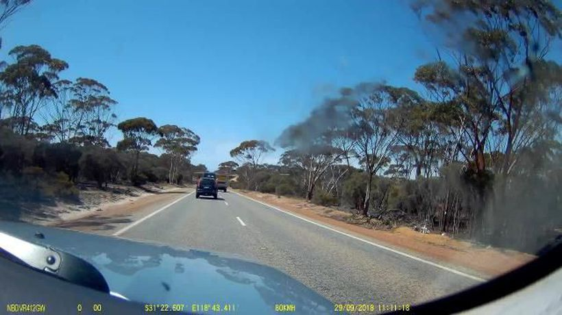 Motorist stunned by truck driver's overtaking on bend