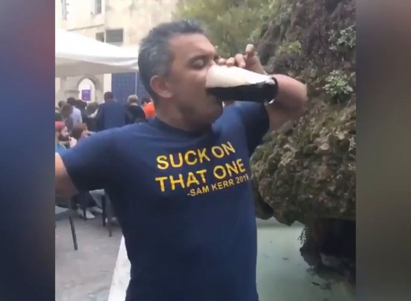 Daniel Kerr skols beer in 'suck on that one' shirt