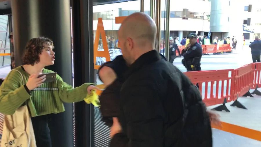 RAW: Protestor clashes with police at SA Liberal Party AGM