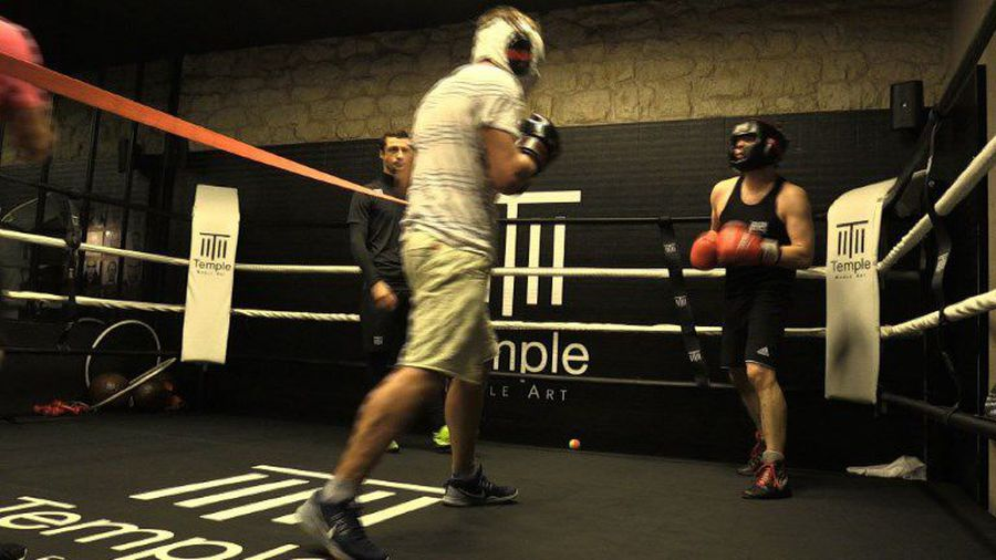 Paris' white-collar boxers trade pressure for punches