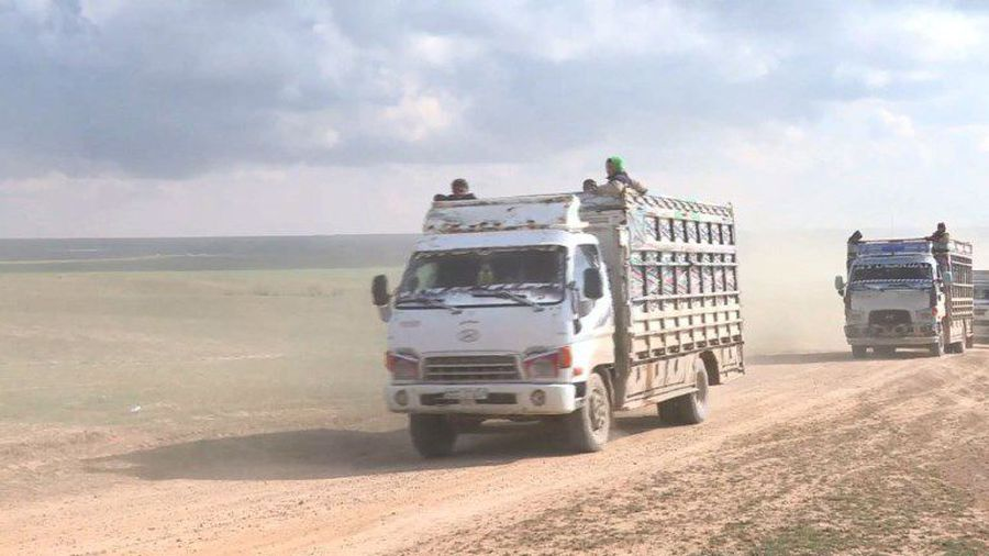 Hundreds flee IS-held holdout in eastern Syria