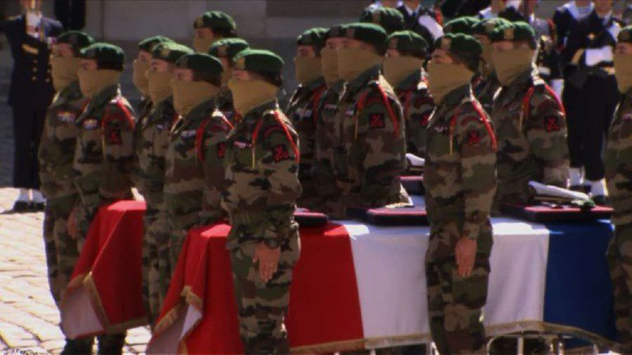 Watch Funeral caskets of fallen French soldiers arrive at Invalides