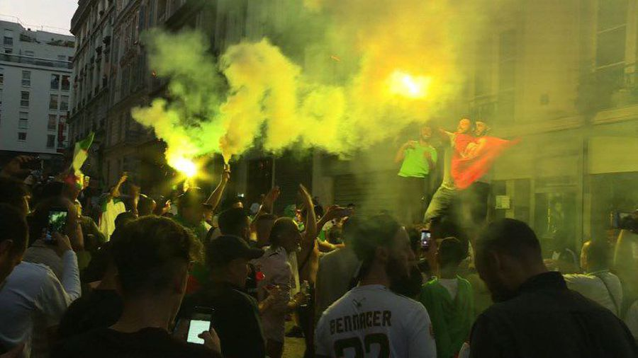 Algerian supporters celebrate in Paris during the AFCON final
