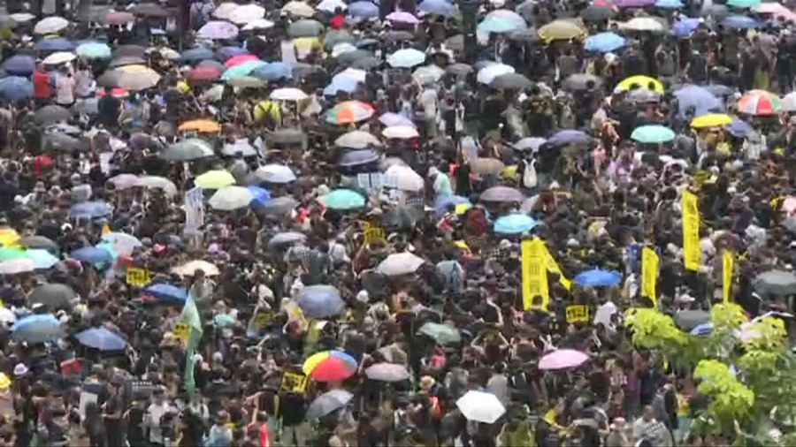 Hong Kong protesters arrive at Victoria Park for planned huge rally
