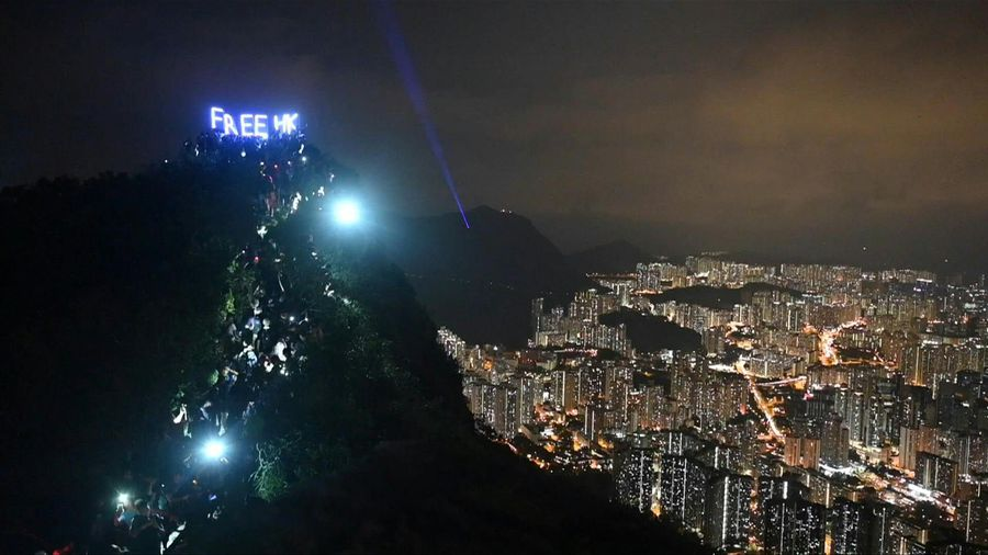 Hong Kong's 'Lion Rock' roars with protest lights and slogans