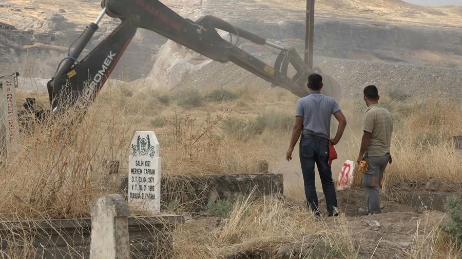 Displacement of graves before flooding of Turkish town