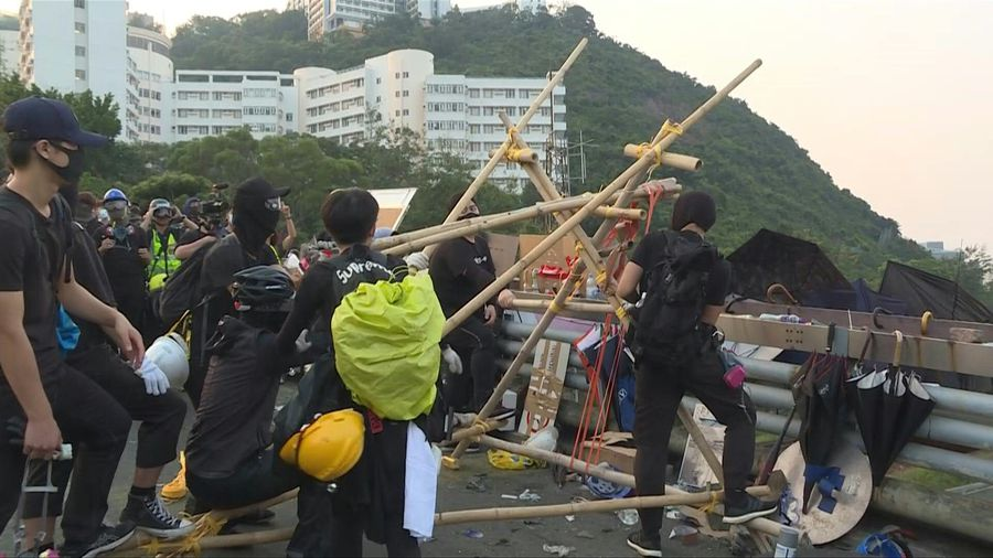 Hong Kong protesters fire catapults and choke city