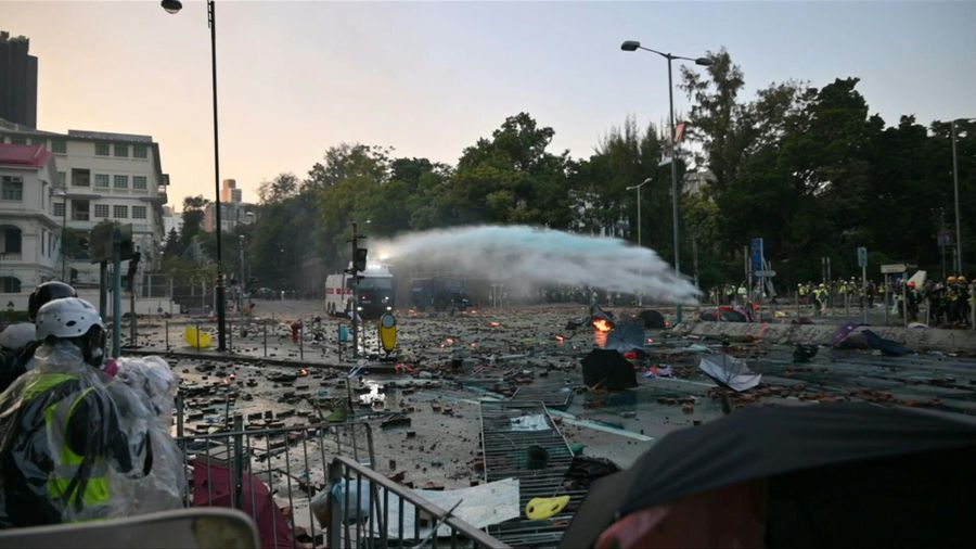 Hong Kong police use water cannons as clashes rage at university