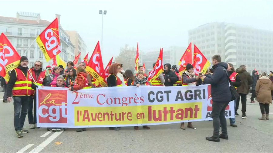 Images of union members and protesters gathering in Lyon