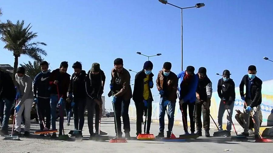 Iraqi volunteers clean up the streets of the central city of Najaf