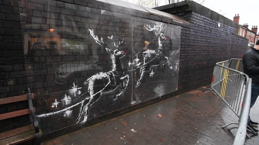 Banksy reindeer mural covered after red noses added