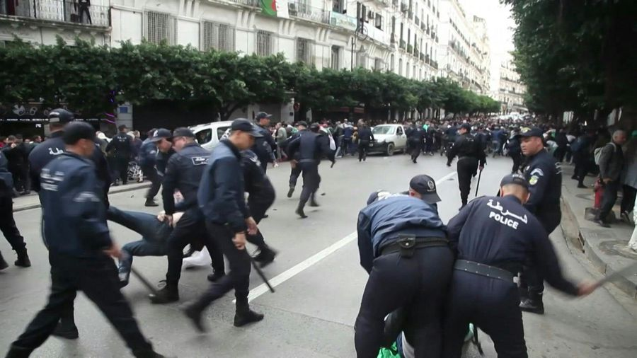 Police forces charge anti-election protesters in Algeria's capital