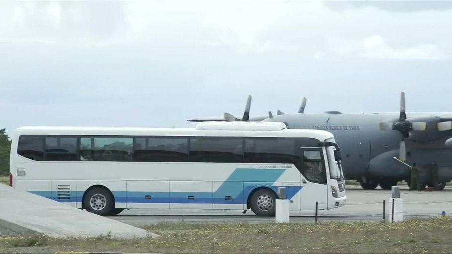 Relatives of crashed Chilean plane victims arrive at military base