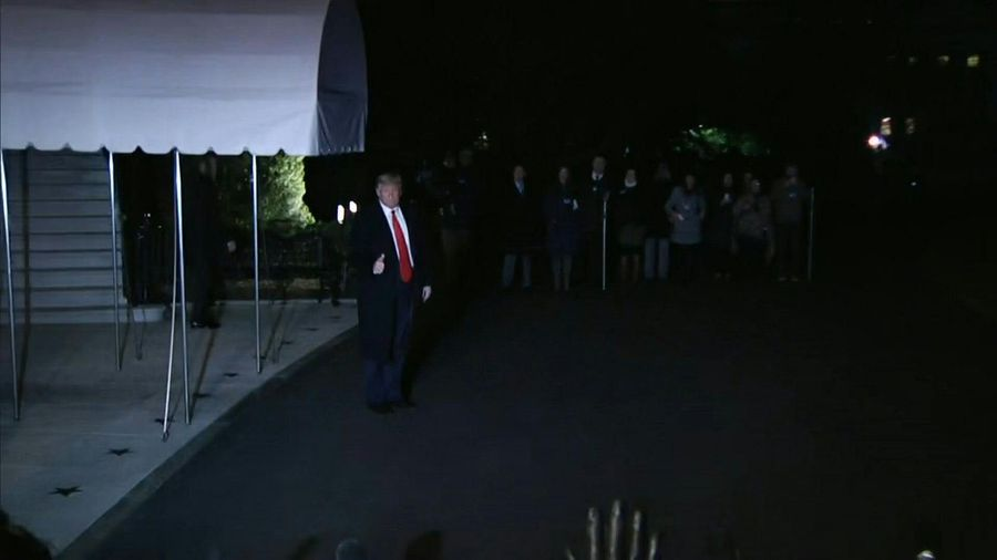 Trump leaves for Davos on eve of Senate trial