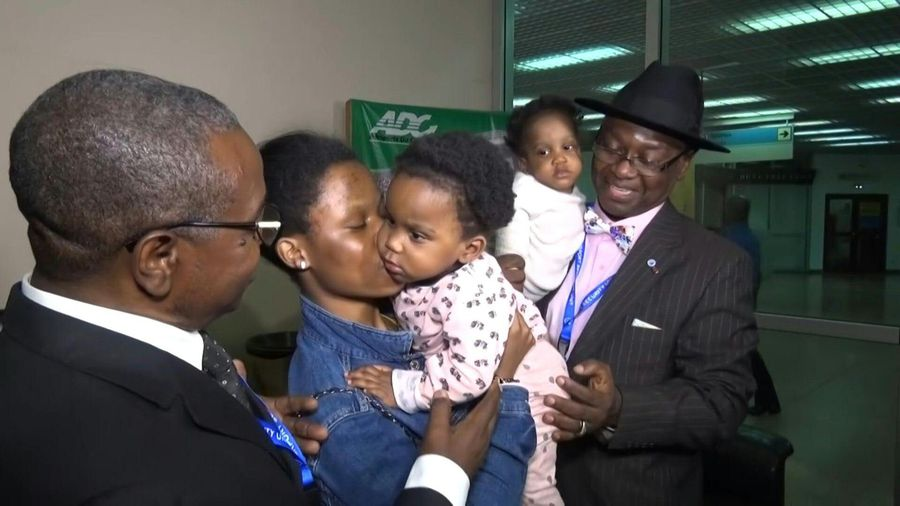 Former conjoined twins return to Cameroon