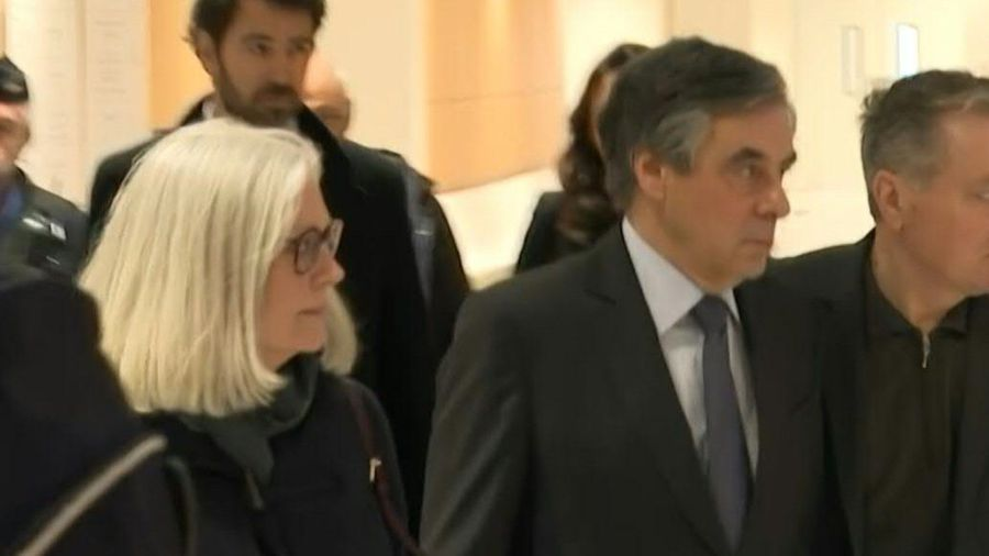 Former French PM arrives in court with wife Penelope at start of fraud trial