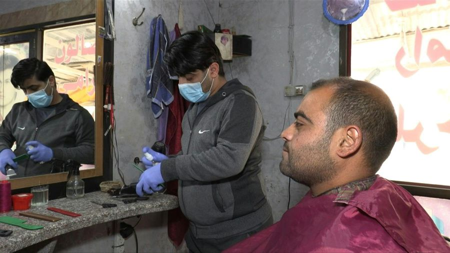 Coronavirus: Gaza barbers sterilise equipment to keep shops running
