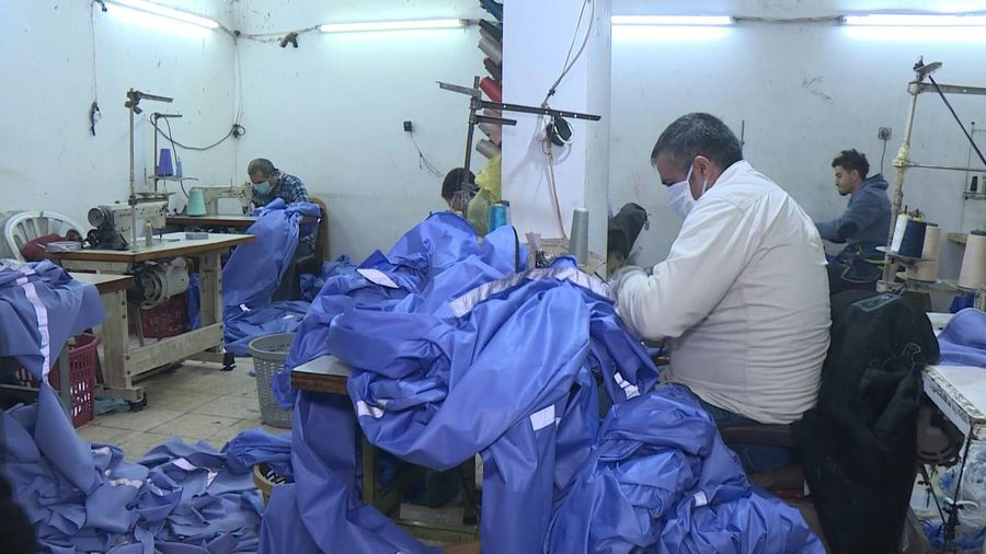 Coronavirus: Gaza factory makes healthcare garments for protection