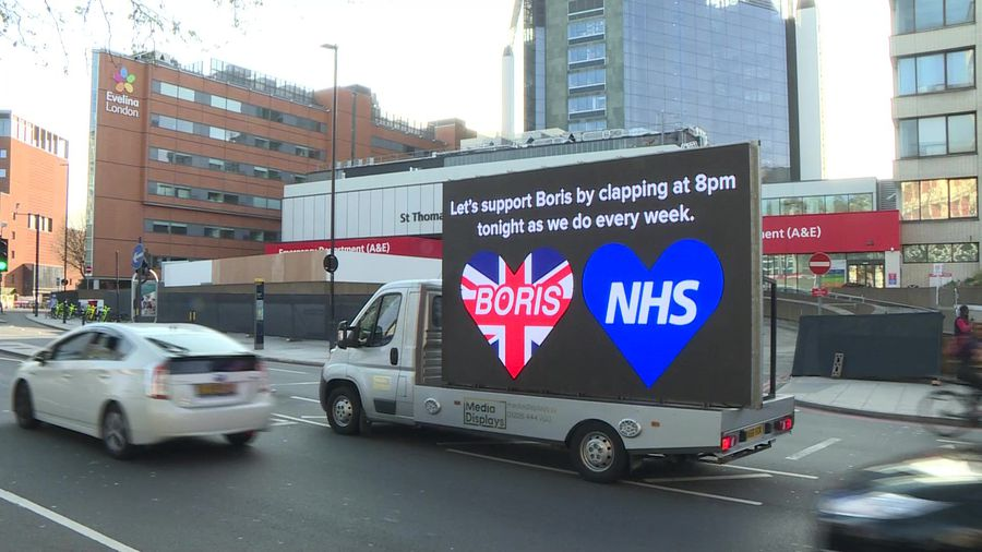 Messages of support for COVID-19 stricken Boris Johnson displayed on LED screen outside London hospi