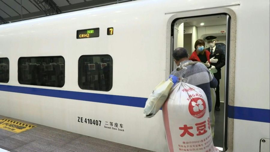 Coronavirus: Wuhan residents at train station as city exit ban lifted