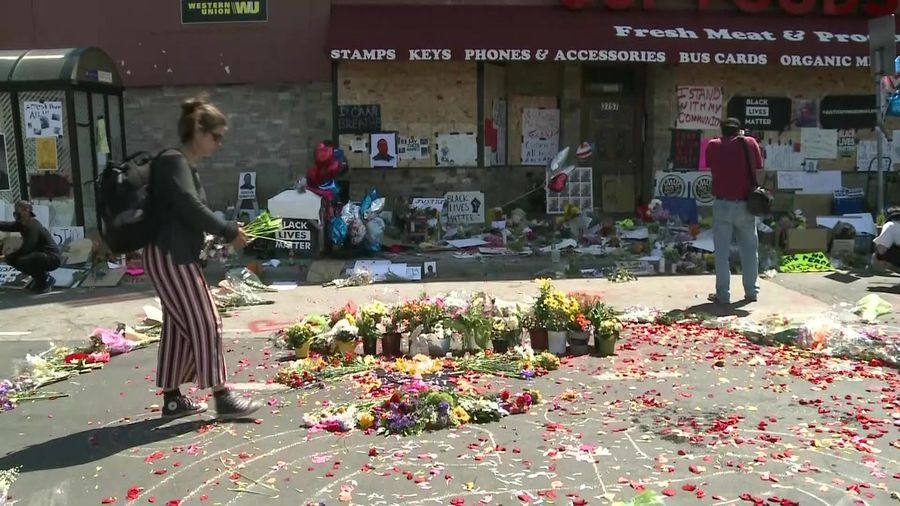 People pay tribute at site of George Floyd's arrest in Minneapolis