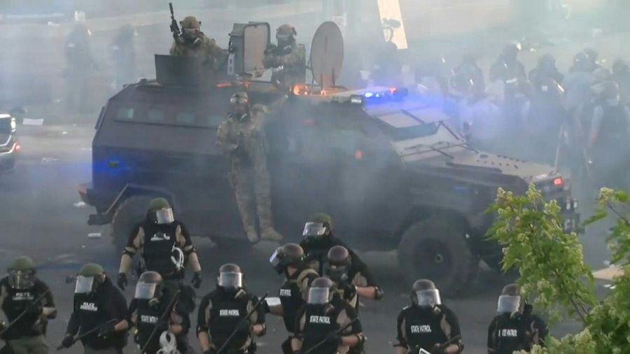 Law enforcement use tear gas to clear out protesters in Minneapolis