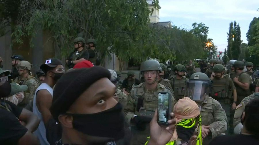 Police watch over crowd of protesters outside White House