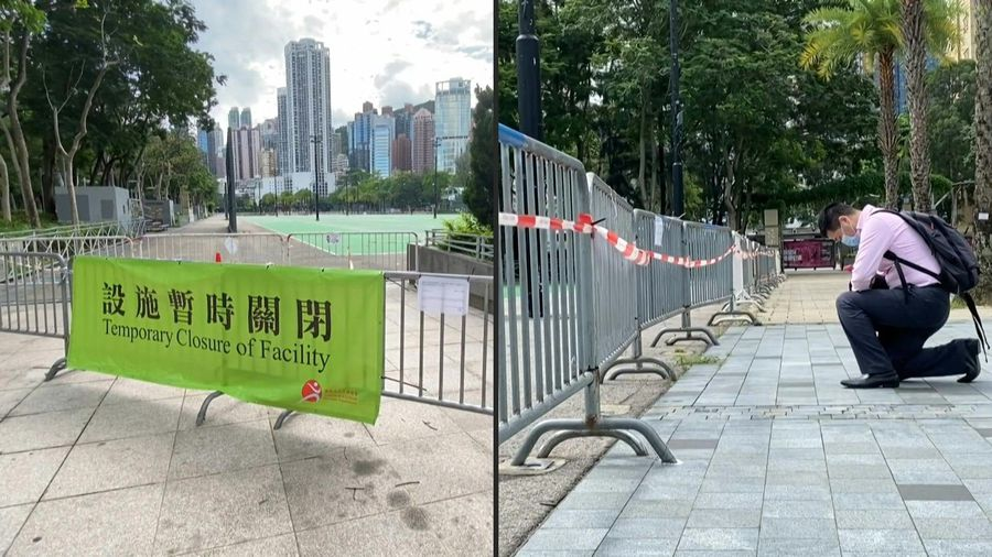 Man kneels at park where HK usually holds Tiananmen vigils