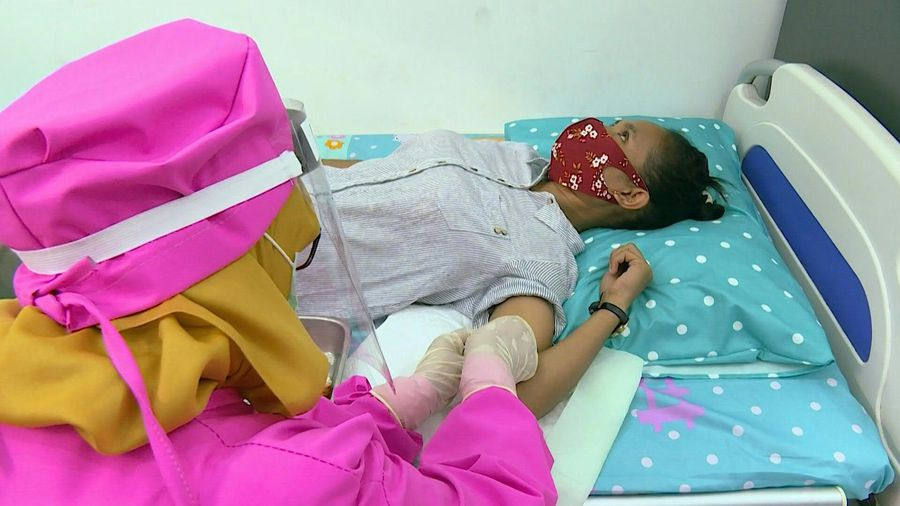 Pandemic baby boom fears spark Indonesia birth-control blitz