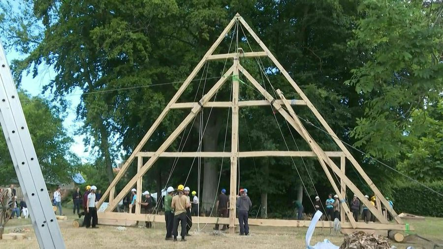 In Normandy, volunteer craftsmen are restoring part of the roof structure of Notre-Dame to its origi
