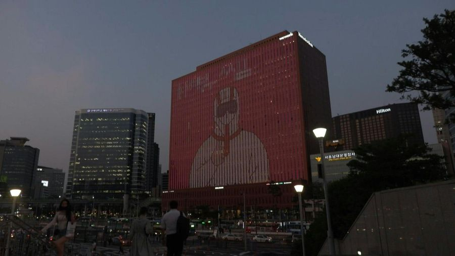 A corporate building in downtown Seoul lights up to thank medical workers and citizens