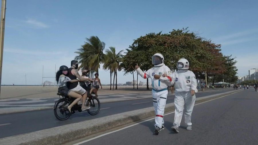 Brazilian couple wear space suits as virus protection