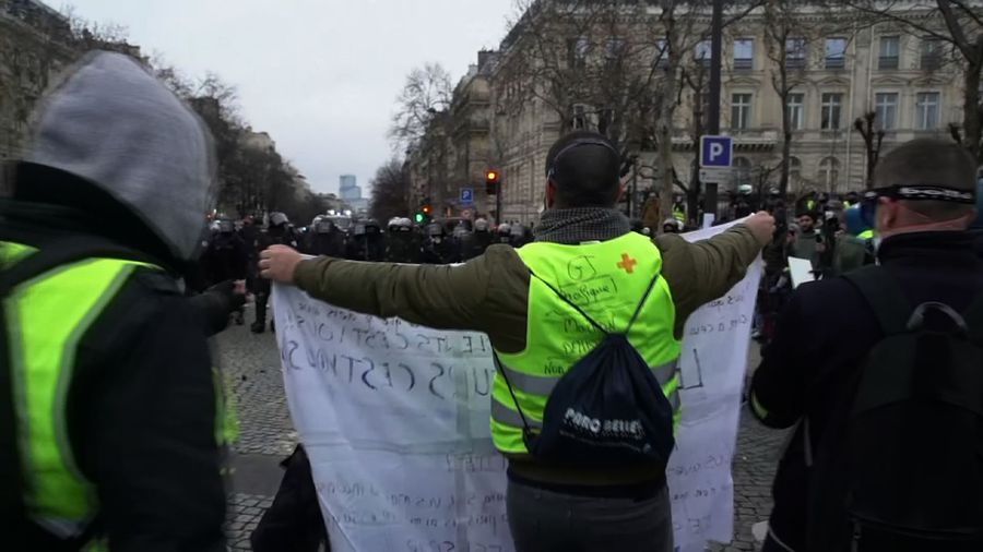 Yellow vests clash with police in central Paris