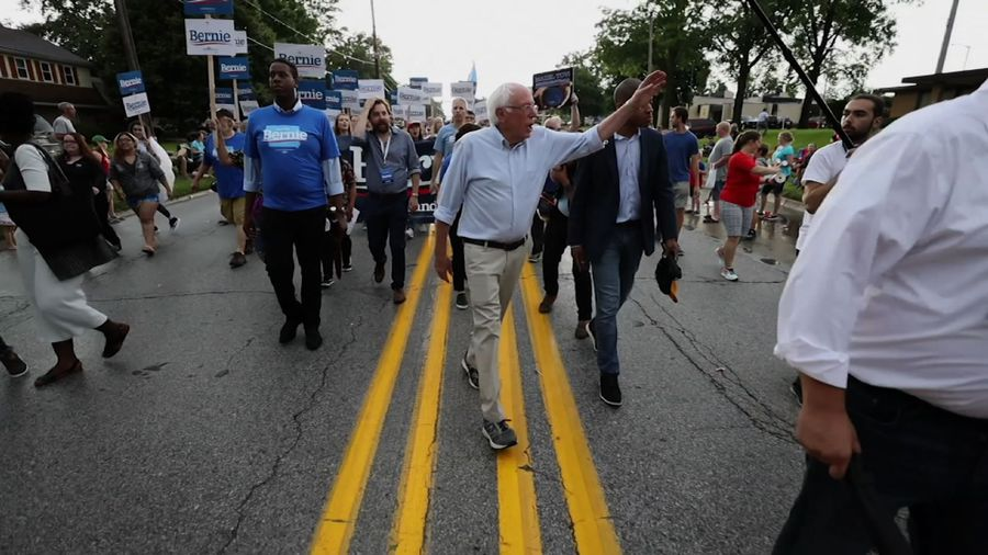 Bernie Sanders walks in Iowa Fourth of July parade