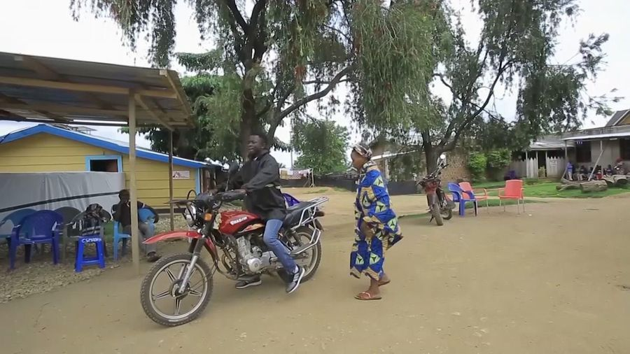 Ebola survivor with bike helps ease fear in Congo