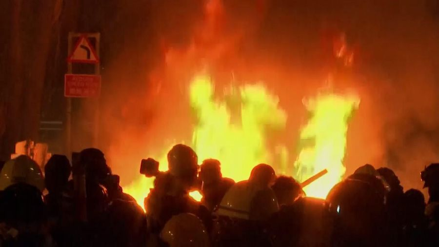 Fires lit up the night as Hong Kong clashes continue