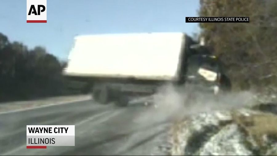 Dash camera shows close call on icy Illinois road