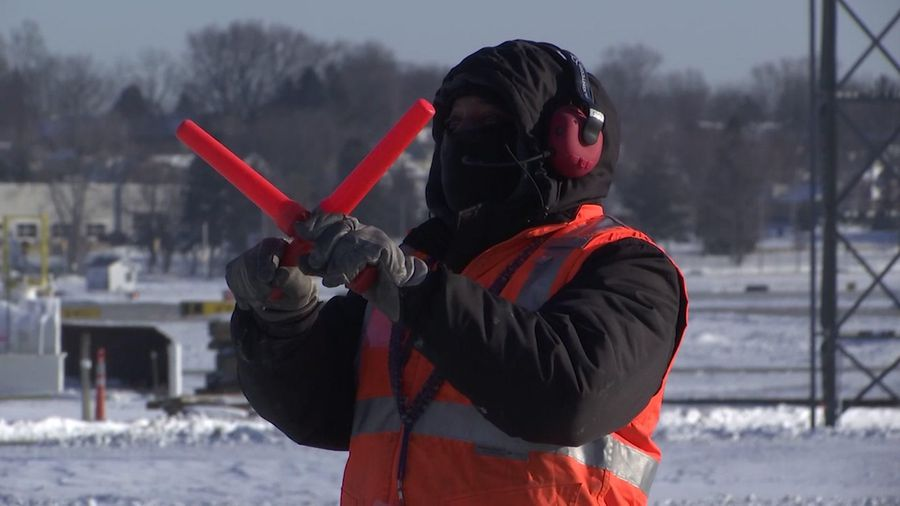 Airport worker stays positive in Midwest cold snap