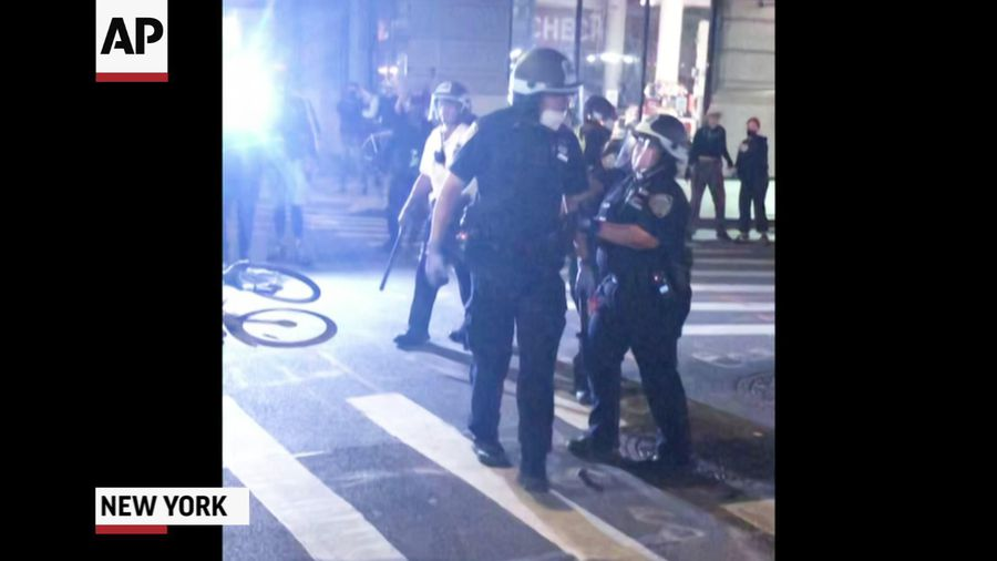 NYPD officer seen pointing gun at crowd