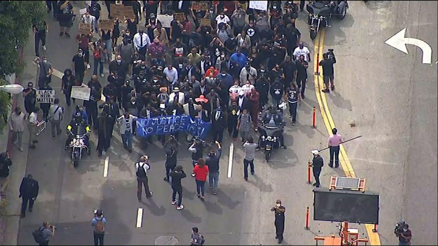 Protesters sit down on downtown Los Angeles street