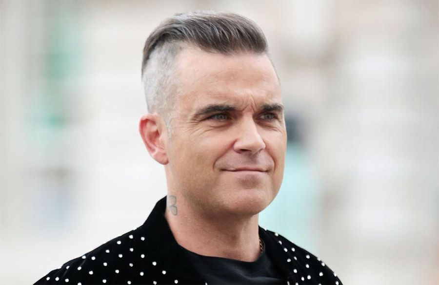 Robbie Williams: 'I don't think money should exist':