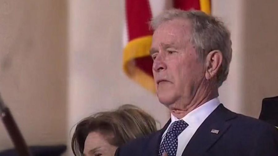 George W Bush holds back his emotions