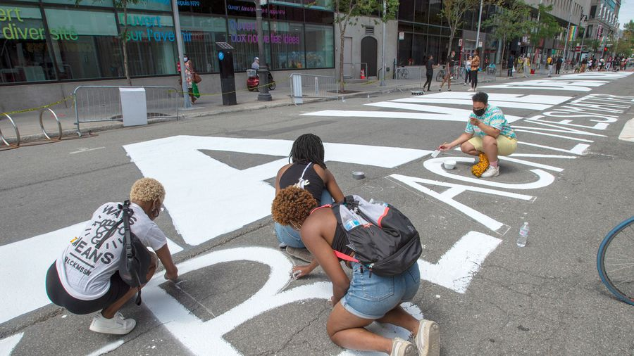 Montreal artists paint 'Black Lives Matter' in rainbow colours on downtown street