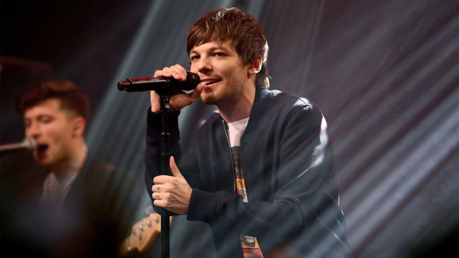 Louis Tomlinson goes through 'moments' of speaking to his One Direction bandmates