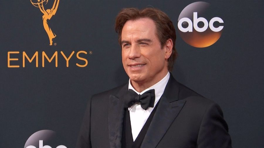 John Travolta unveils completely bald head after shock makeover