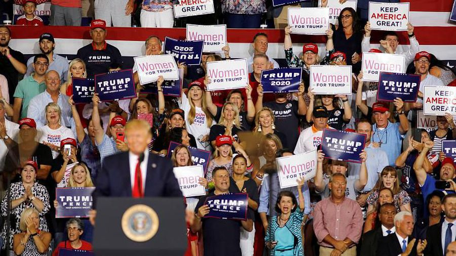Crowd chants 'send her back' at rally after Trump accused of racism