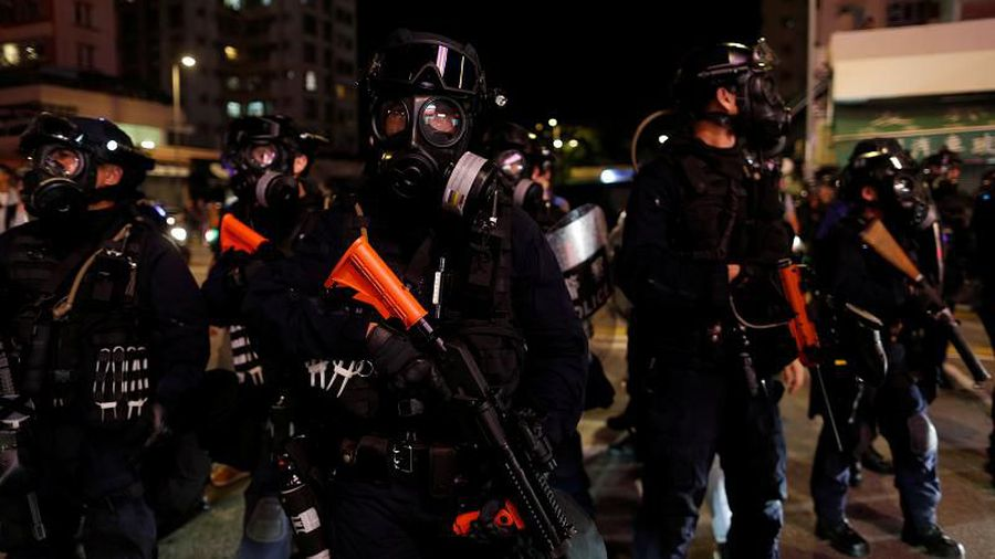 Police in Hong Kong fire tear gas at anti-government protesters
