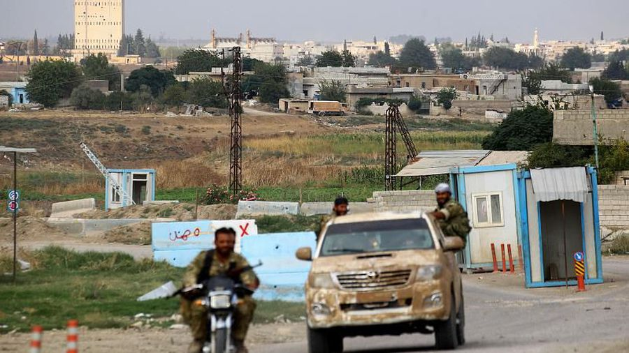 Kurdish fighters pull out of Syrian border town while Erdogan expects US to 'keep promises'