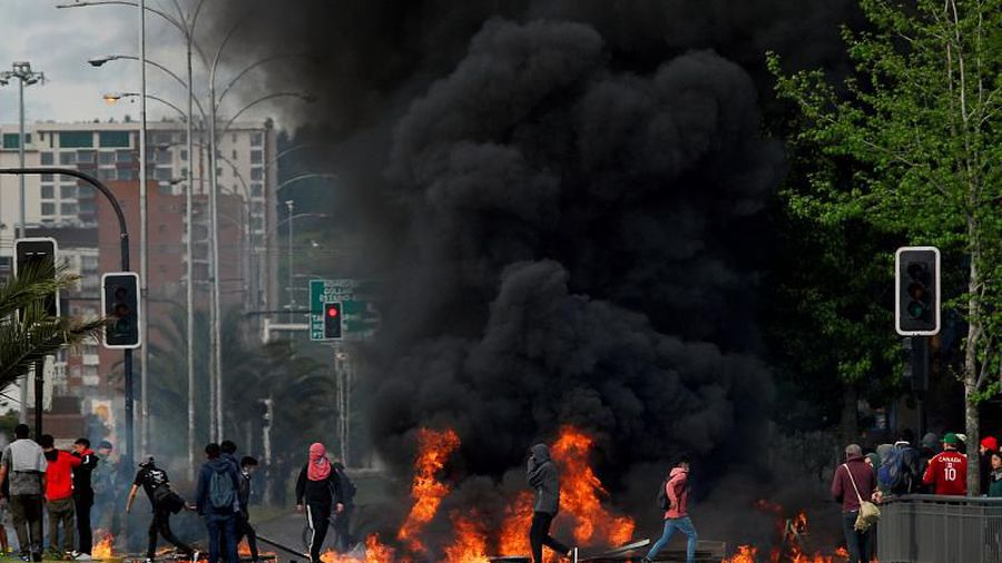Riots in Chile leave at least seven dead as government extends state of emergency