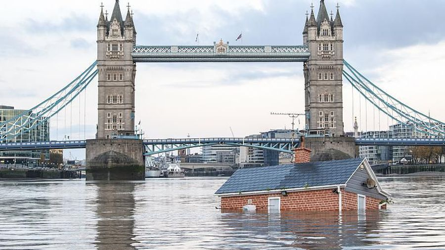 """Extinction Rebellion floats British house mock-up """"sinking"""" in Thames in climate protest"""
